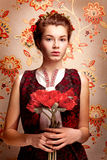 Traditional girl with poppies. On flowers background Royalty Free Stock Photography