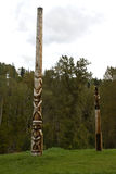 Traditional Gitxsan totem poles, village of Gitanyow Royalty Free Stock Images