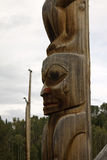 Traditional Gitxsan totem poles, village of Gitanyow Royalty Free Stock Photos