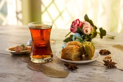 Traditional glass of Turkish tea with baklava Royalty Free Stock Photography