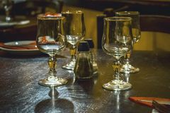 Traditional glasses arrangement. In Maltese tavern in Malta Royalty Free Stock Photography