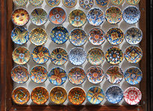 Traditional glazed ceramic plates. Front view of a collection of some traditional glazed ceramic small plates, colorful, from sicily, landscape cut Stock Image