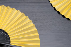 Traditional golden folding fan Stock Images
