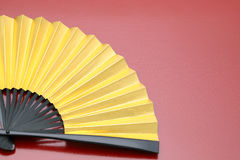 Traditional golden folding fan Royalty Free Stock Images