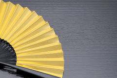 Traditional golden folding fan Royalty Free Stock Image