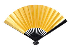 Traditional golden folding fan Stock Image