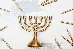 Traditional golden Hanukkah candleholder and candles on white ba Royalty Free Stock Photography