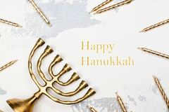 Traditional golden Hanukkah candleholder and candles on white ba Royalty Free Stock Image