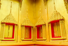 The traditional golden windows and frames of  buddhist temple,Thailand. Stock Photo