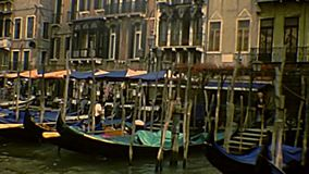 Archival Venice gondola boats. Traditional gondola boats of Venice. Archival of Venezia city of Italy in the 1980s. Canal Grande view from the traditional stock footage