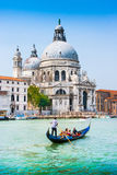 Traditional Gondola on Canal Grande with Basilica di Santa Maria della Salute in Venice, Italy Royalty Free Stock Photos