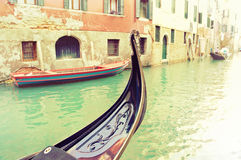 Traditional gondola moored on a venetian canal - Venice, Italy Royalty Free Stock Image
