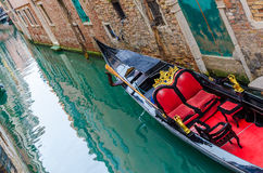Traditional Gondola over emerald water Royalty Free Stock Photography