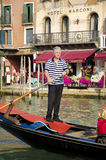 Traditional Gondola rower in Venice, Italy royalty free stock photography