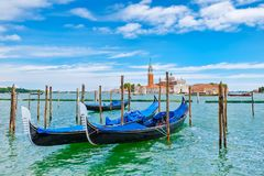Traditional gondolas docked on the Grand Canal next to St Mark& x27;s Square in Venice Royalty Free Stock Photography