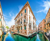 Traditional Gondolas on narrow canal between colorful houses, Venice, Italy royalty free stock photo