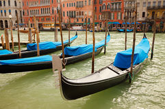 Traditional gondolas in Venice. Traditional gondolas on Grand Canal in Venice Royalty Free Stock Images