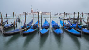 Traditional Gondolas in Venice. Beautiful view of traditional Gondolas in Venice with church of San Giorgio Maggiore in the bacground - blured Royalty Free Stock Image