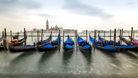 Traditional Gondolas in Venice. Beautiful view of traditional Gondolas in Venice with church of San Giorgio Maggiore in the bacground - blured Stock Images