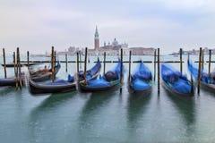 Traditional Gondolas in Venice. Beautiful view of traditional Gondolas in Venice with church of San Giorgio Maggiore in the bacground - blured Stock Photos
