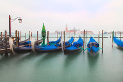 Traditional Gondolas in Venice. Beautiful view of traditional Gondolas in Venice with church of San Giorgio Maggiore in the bacground - blured Royalty Free Stock Photography