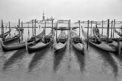 Traditional Gondolas in Venice in black and white. Beautiful view of traditional Gondolas in Venice with church of San Giorgio Maggiore in the bacground, black/ Royalty Free Stock Image