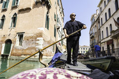 Traditional gondolier rowing through the channels view from gondola Stock Photography