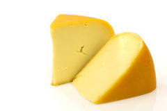 Traditional Gouda cheese pieces stock image