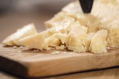 Traditional grana padano italian cheese on olive board Royalty Free Stock Images
