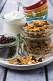 Traditional granola with raisins. And nuts in a bowl on the table. Selective focus Stock Photos