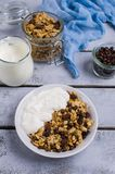 Traditional granola with raisins. And nuts in a bowl on the table. Selective focus Royalty Free Stock Images
