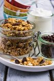Traditional granola with raisins. And nuts in a bowl on the table. Selective focus Stock Image