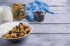 Traditional granola with raisins. And nuts in a bowl on the table. Selective focus Stock Photography