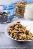 Traditional granola with raisins. And nuts in a bowl on the table. Selective focus Stock Photo