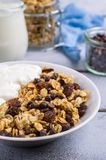 Traditional granola with raisins. And nuts in a bowl on the table. Selective focus Royalty Free Stock Photo