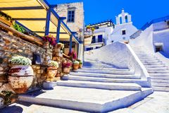 Traditional Greece - charming floral streets with tavernas, Naxo Stock Photography