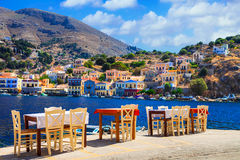 Traditional Greece - small street tavernas in Symi island, Dodec Stock Photos