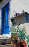 Traditional greek blue door and terracota ceramic jugs, Greece Stock Photos