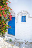 Traditional greek blue doors. In white painted wall Royalty Free Stock Photos