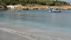 The traditional Greek boat for fishing near beach. Crete, Greece stock footage