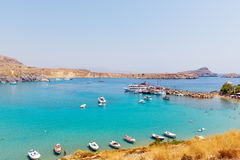 Traditional greek boats at beautiful lagoon near Lindos town on Rhodes island, Greece Royalty Free Stock Photo