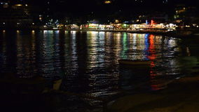 The traditional Greek boats for fishing and shore in night illumination. Crete, Greece stock footage