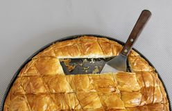 Cheese pie. Traditional greek Cheese pie cut in pieces Royalty Free Stock Photography