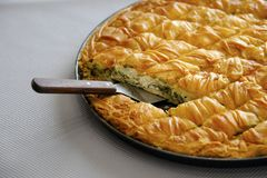 Cheese pie close up cut in pieces. Traditional greek Cheese pie in pan cut in small pieces Royalty Free Stock Photos