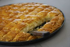 Cheese pie in pieces. Traditional greek Cheese pie in pieces in pan Stock Image