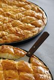 Spinach pie and Cheese pie in pieces. Traditional greek Cheese pie and spinach pie in pan Stock Photo