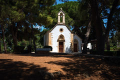 Traditional Greek church in a forest near Chania town on Crete island Stock Photos
