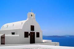 Traditional Greek church by the sea Royalty Free Stock Photography