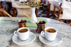 Traditional Greek Coffee in pot and Coffee Cups Stock Photos