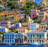 Traditional greek colorful houses in Symi island. Dodecanese, Greece. Traditional greek colorful houses in the Symi island. Dodecanese, Greece royalty free stock images